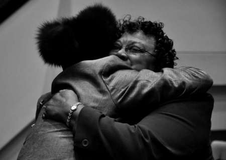 Marisha Jackson embraces a fellow church member after Sunday service has ended at Mount Zion Baptist Church.