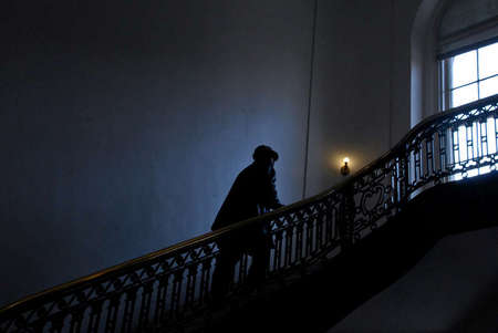 A man walks up the steps of the U.S. House of Representatives Main Interior Building on Constitution Avenue.