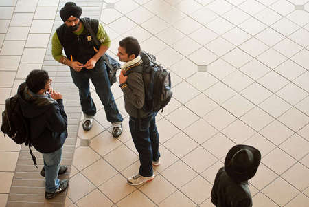 Students conversing at Engineering building before class starts.