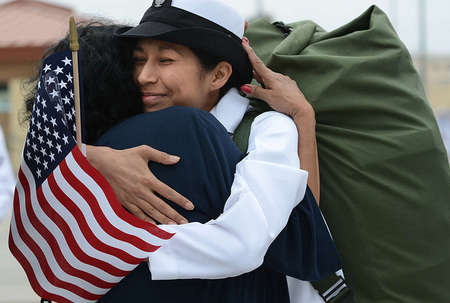 Petty Officer Amy Beech of the USS Carl Vinson, embraces her mother, Julia Acosta, after six months of being away at sea.