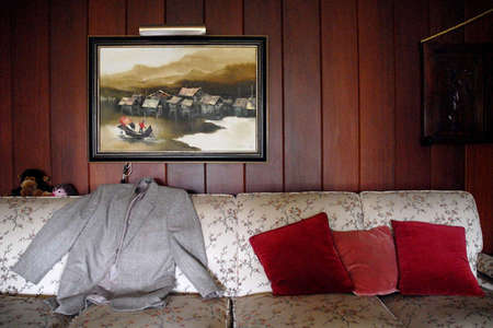 Dwight Bentel's personal items in his living room. the 100 year old man always has his coat ready to go for business.