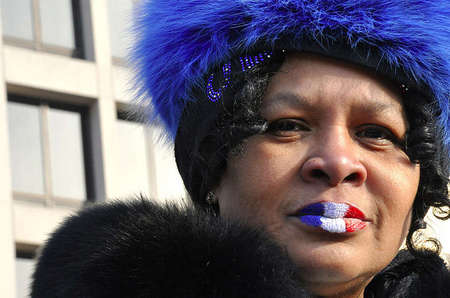 "Euretha Henderson, 66, wears the colors of the U.S. flag on her lips to symbolize her patriotism and, what she called ""the awaited day"" of the first black president of the United States, Barack Obama."
