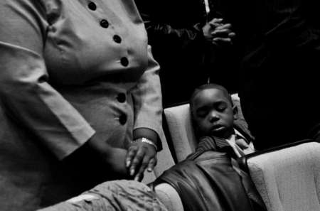 Marcus Phillips, 6, sleeps during a Sunday service at Mount Zion Baptist Church.