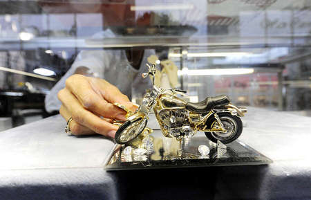 Angela displays a wax-based motorcycle model ordered by a loyal customer. Tim not only makes rings and toy figurines of vehicles but has been asked many times to even create sculpture from sketches.