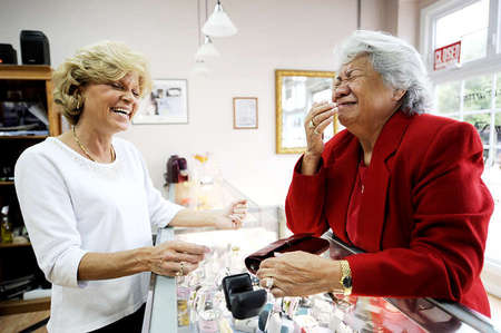 Angela and Sarah Vineyard, a loyal customer of Stoll's, share a laugh after discovering that Ms. Vineyard's daughter-in-law, Lisa, bought the same bracelet as her without her knowing about it.