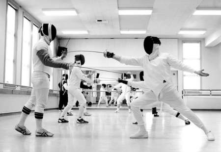 Man-Sum Lai, a first year graduate student in the fencing program, and Jeremy Taven, an instructor in arms candidate, practice their swordsmanship during a Saturday class at Washington Square Hall.