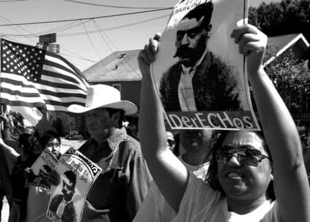 Olivia Hernandez and company carry a poster of Emiliano Zapata, a Mexican revolutionary, as a sign of rebellion towards the U.S. government.