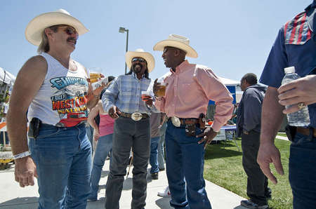 Cowboy enthusiasts and local Morgan Hill-Gilroy residents Art Hannibal (left), Jethro Bledsoe and Darryl Dewaywe Searigril shares some drinks at laughs at the first annual Morgan Hill BBQ Cook-off outside the Community Center.