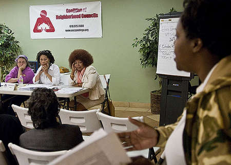 Board of directors of the non-profit Coalition of Neighborhood Councils, Treasurer Elaine Kennedy(left), Chairwoman Barbara Howard, and Vice Chairwoman Marry Young, listen to community residents complaints and criticism about how the organization has been handling its agenda and finances.