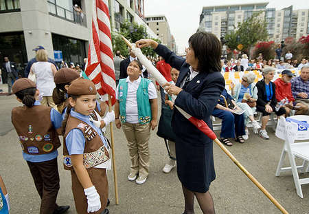 "Irene Barajas, Girl Scout Leader of Group S912 San Ysidro, prepares the California flag for a ""call of the guard"" at the San Diego New Central Library groundbreaking ceremony in downtown San Diego."
