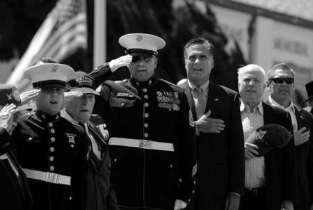 Republican presidential candidate Mitt Romney and Senator John McCain sing along during the national anthem at a memorial day event in San Diego.
