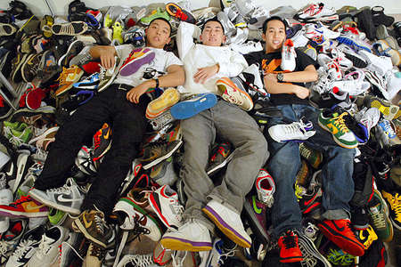 Jason Wong and his roommates, Aaron Chiang, center, and Adrian Lui, have 300 pairs of limited-edition sneakers among them, crammed into their San Jose two-bedroom apartment. Total spent over the years: nearly $30,000.